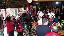 Fletcher Armstrong, with the Calgary Grey Cup committee, rides his horse, Marty, in the front foyer of the Royal York hotel Thursday, Nov. 22, 2012 in Toronto. (The Canadian Press)