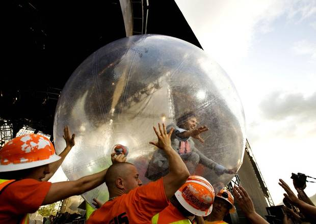 Wayne Coyne, lead singer of the Flaming Lips, starts his show by rolling over the audience in a plastic bubble at the 2008 Pemberton Music Festival.