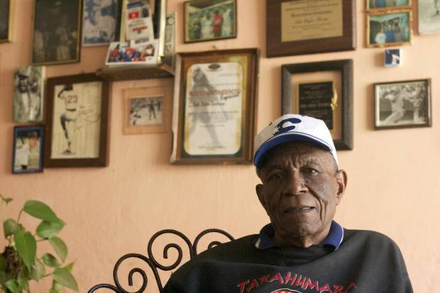 Luis Zayas, a former Havana Sugar Kings player, with photographs of Cuban players on his wall in Havana, March 7, 2013. For more than six seasons in prerevolutionary Cuba, the Sugar Kings were the Cincinnati Reds' Class AAA affiliate in Havana.