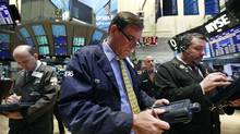 Traders work on the floor of the New York Stock Exchange, March 27, 2012. (Brendan McDermid/Reuters)
