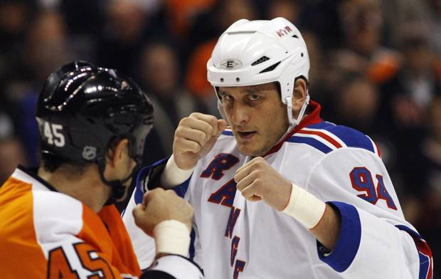 FILE - In this Nov. 4, 2010, file photo, Philadelphia Flyers' Jody Shelley, left, and New York Rangers' Derek Boogaard fight during an NHL hockey game in Philadelphia. Boogaard, at age 28, died on Friday. Boogaard signed with the Rangers as a free agent in July,2010 appearing in 22 games last season, registering one goal and one assist.
