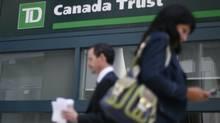 People walk past a Toronto-Dominion Bank branch in Ottawa (CHRIS WATTIE/REUTERS)