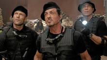 From left, Jason Statham, Sylvester Stallone and Randy Couture in The Expendables. (Karen Ballard/AP)