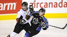 Kootenay Ice's Cody Eakin, right, takes a push from Calgary Hitmen's Alex Roach during first period WHL hockey action in Calgary, Alberta on Wednesday, Feb, 2, 2011. (LARRY MACDOUGAL/The Canadian Press)