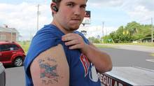 Eric Henderson and his Pinto tattoo (Peter Cheney/The Globe and Mail)