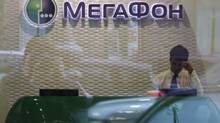 A member of staff works in a MegaFon retail outlet in Moscow on September 4, 2012. (MAXIM SHEMETOV/REUTERS)