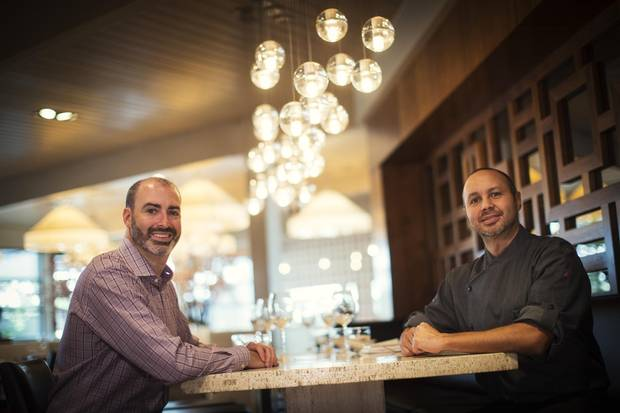 Alloy restaurant chef and owners Uri Heilik, left, and Rogelio Herrera at their restaurant in Calgary.