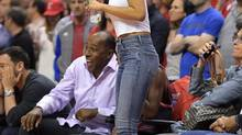 Singer Rihanna watches the Los Angeles Clippers play the Oklahoma City Thunder in the second half of Game 6 of the Western Conference semifinal NBA basketball playoff series, Thursday, May 15, 2014, in Los Angeles. (Mark J. Terrill/AP)