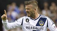 LA Galaxy's David Beckham argues a call with the referee as they face the Montreal Impact during first half MLS soccer action in Montreal on Saturday, May 12, 2012. THE CANADIAN PRESS/Paul Chiasson (Paul Chiasson/CP)