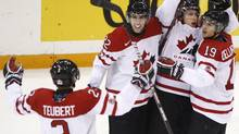 Team Canada Colten Teubert, Jared Cowen, Luke Adam and Stefan Della Rovere, left to right, celebrate a goal by Adam against Team Slovakia during second period action at the World Junior Hockey Championship in Saskatoon, Sask., on Tuesday, Dec. 29, 2009. THE CANADIAN PRESS/Nathan Denette (Nathan Denette)