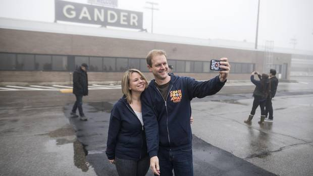 Irene Sankoff, left, and David Hein, the husband and wife writing team behind the musical Come From Away take a selfie on the tarmac of the Gander International Airport in Gander, N.L. on Sunday, October 30, 2016.