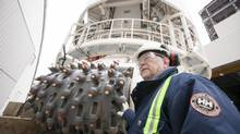 John Stubbs, Jansen project manager, with the Herrenknecht driller that will be used at the BHP Jansen mine. (DAVID STOBBE FOR THE GLOBE AND MAIL)