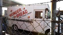 A Wonder bread delivery truck is parked with behind fencing at a Hostess Bakery Thriftshop that remains open selling baked goods in Glendale, California November 26, 2012. (FRED PROUSER/REUTERS)