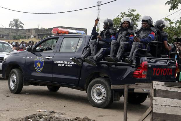Congolese police patrol outside the main prison in Kinshasa, Congo, Wednesday May 17, 2017.