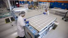 Workers manufacture solar panels at a Silfab facility in Mississauga. Ontario, the province most reliant on manufacturing, is now the second largest recipient of federal equalization payments ($2.2-billion in 2011-2012). (Kevin Van Paassen/Kevin Van Paassen/The Globe and Mail)