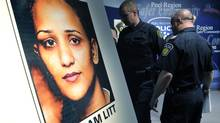 Peel Police leave a press conference where they announced that the remains of Poonam LITT, who had gone missing in 2009, were discovered in Caledon, during a news conference in Brampton, April 12, 2012. (J.P. MOCZULSKI/J.P. Moczulski for The Globe and Mail)