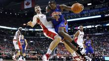 New York Knicks Amar'e Stoudemire drives to the net against Toronto Raptors Andrea Bargnani (L) during the first half of their NBA game in Toronto, October 27, 2010. (MARK BLINCH/REUTERS)
