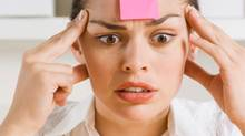 Businesswoman with sticky note on forehead (Pixland/Getty Images/Pixland)