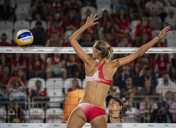 Canadians Sarah Pavan blocks ball by team Swiss in preliminary beach volleyball action at Rio Olympics August 10, 2016. (John Lehmann/The Globe and Mail)