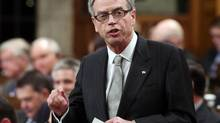 Finance Minister Joe Oliver stands in the House of Commons during Question Period on Parliament Hill, in Ottawa on March 27. (FRED CHARTRAND/THE CANADIAN PRESS)