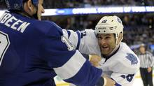 Tampa Bay Lightning right wing B.J. Crombeen, left, and Toronto Maple Leafs right wing Mike Brown fight during the first period of an NHL game Tuesday, Feb. 19, 2013, in Tampa, Fla. (Brian Blanco/AP)