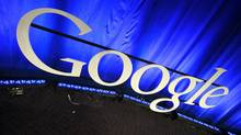 This file photo taken April 9, 2010, shows a Google sign at Google headquarters in Mountain View, Calif. Google said Tuesday, Jan. 25, 2011, it plans to hire more than 6,200 workers this year in the biggest expansion yet by the Internet's most profitable company. (Paul Sakuma/AP)