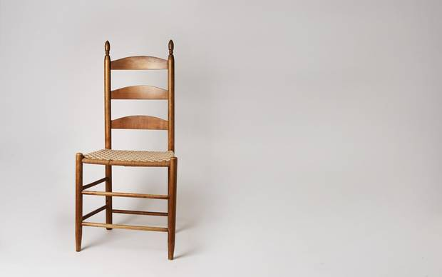 A circa 1910 ladder-back chair from the Shaker Museum.