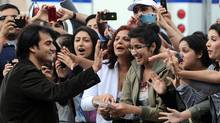 Indian actor Arbaaz Khan acknowledges fans during a green carpet event on June 24, 2011 ahead of the 2011 International Indian Film Academy (IIFA) awards in Toronto. (Jewel Samad/AFP/Getty Images/Jewel Samad/AFP/Getty Images)