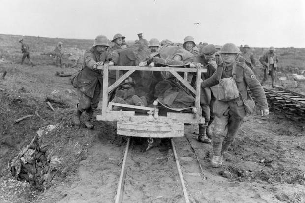 Wounded Canadian soldiers are brought to the field dressing station at Vimy Ridge in April, 1917.