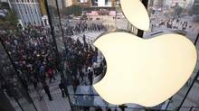 In this Oct. 20, 2012 photo, Chinese people line up to enter a newly opened Apple Store in Wangfujing shopping district in Beijing. A Chinese court has ordered Apple Inc. to pay 1.03 million yuan ($165,000) to eight Chinese writers and two companies who say unlicensed copies of their work were distributed through Apple's online store. (Andy Wong/AP)