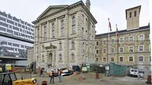 Scaffolding recently came down at the Don Jail, revealing the restoration of the pre-Confederation building in Toronto. It is being repurposed as administrative offices for the new glass-exterior Bridgepoint hospital, left, and will reopen next spring. (Mario Madau/+VG Architects)