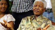 Nelson Mandela at a news conference in Johannesburg after his only surviving son, Makgatho Mandela, had died Thursday, Jan. 6, 2005. Mr. Mandela told reporters that his son had died of AIDS. On left is Mandela's granddaughter and daughter of Makgatho, Makaziwe Mandela. (AP Photo)