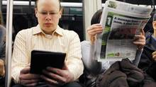 A commuter reads on a Kindle while riding the subway in Cambridge, Mass. Barnes & Noble will launch its Nook e-books reader in the U.K. this autumn, marking the first time the U.S. bookseller has expanded overseas in its 95-year history. (BRIAN SNYDER/REUTERS)