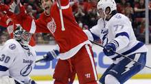 Detroit Red Wings' David Legwand, center, celebrates his goal against Tampa Bay Lightning's Ben Bishop (30) and Victor Hedman (77), of Sweden, during the second period of an NHL game, Sunday, March 30, 2014, in Detroit. (Duane Burleson/AP)