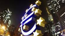 The Euro sculpture stands in front of the European Central Bank in Frankfurt, Germany. (Michael Probst/Michael Probst/AP)