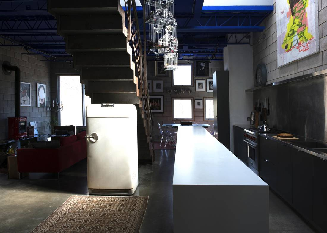 The kitchen's 15-foot-long island is clad in Corian, a non-porous material that can be buffed out when cut or scratched.