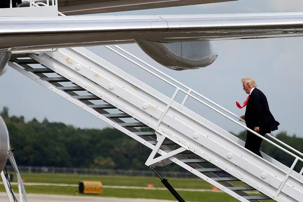 Donald Trump boards his plane following a campaign rally in Tampa, Florida, in August.