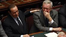 Italy's Prime Minister Silvio Berlusconi, left, and Finance Minister Giulio Tremonti (TONY GENTILE/REUTERS)