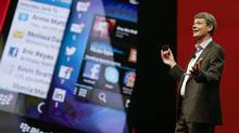 Thorsten Heins, president and CEO at Research In Motion, holds up the new BlackBerry 10 mobile device at a conference, Tuesday, May 14, 2013, in Orlando, Fla. The company's annual general meeting in Waterloo, Ont., on Tuesday morning is likely to be dominated by questions about RIM's disappointing fiscal first-quarter results. (John Raoux/AP)