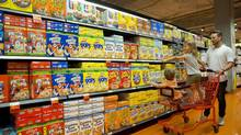 A father and his children shop for cereal at the Loblaws at Maple Leaf Gardens in Toronto on Wednesday, July 23, 2014. (Matthew Sherwood/Matthew Sherwood for The Globe a)