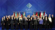Leaders of the G20 pose for the family picture in Los Cabos, Mexico, on June 18, 2012. (EDGARD GARRIDO/REUTERS)