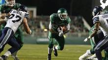 Saskatchewan Roughriders running back Will Ford runs in a touchdown while playing against the Toronto Argonauts during the first half of their CFL football game in Regina, Saskatchewan July 26. (DAVID STOBBE/REUTERS)