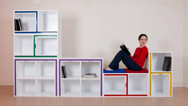 This bookcase houses four chairs, a table and of course, books. (Mark Duggan)