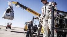 Pilot Felix Baumgartner of Austria leaves his capsule after his mission was aborted due to high winds in Roswell, New Mexico, in this October 9, 2012 handout photo. The Austrian daredevil called off his death-defying skydive from a balloon 23 miles (37 km) over the New Mexico desert on Tuesday because of winds at the launch site. (HANDOUT/Reuters)