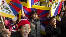 Exiled Tibetans shout slogans during a protest in solidarity with Tibetans who have self-immolated in Dharmsala, India, Thursday, Nov. 8, 2012. Three teenage monks and a Tibetan woman set fire to themselves to protest Chinese rule on the eve of a pivotal Communist Party congress, activists reported Thursday, in what they said were the most such protests in a single day. (Ashwini Bhatia/AP)