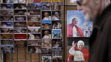 Postcards and calendars are displayed outside a shop at the Vatican. (Max Rossi/Reuters)