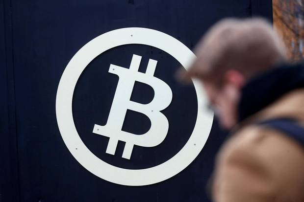 A bitcoin sign is seen during Riga Comm 2017, a business technology and innovation fair in Riga, Latvia on November 9, 2017.