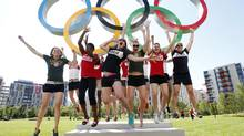 Canada's women basketball team members jump in the air in front of the Olympic rings at the London 2012 Olympic Games village in Stratford, east London July 24, 2012. (SUZANNE PLUNKETT/REUTERS)