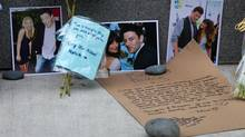 Photographs and notes are placed at a memorial for Canadian actor Cory Monteith outside the Fairmont Pacific Rim Hotel in Vancouver on July 15, 2013. (DARRYL DYCK/THE CANADIAN PRESS)