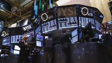Traders work on the floor of the New York Stock Exchange, September 16, 2013. (BRENDAN MCDERMID/REUTERS)